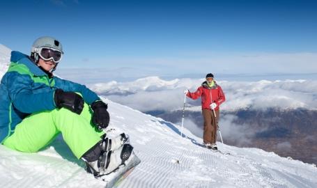 Skier and boarder in Glencoe, Scotland